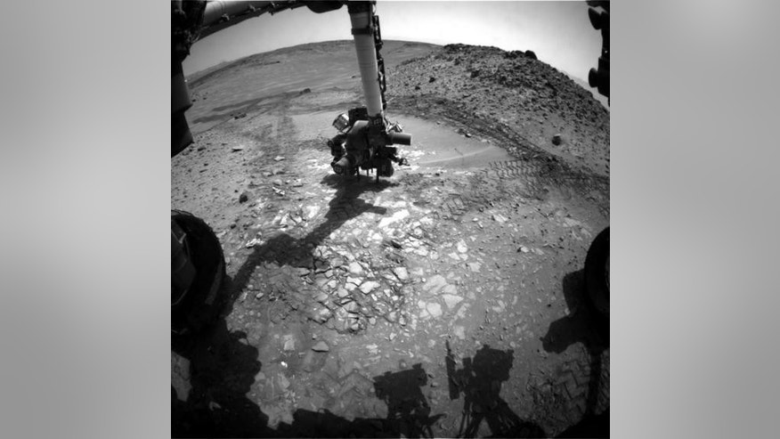 """NASA's Curiosity Mars rover found the rock named, """"Bonanza King,"""" unsuitable for drilling. Image released Aug. 22, 2014."""