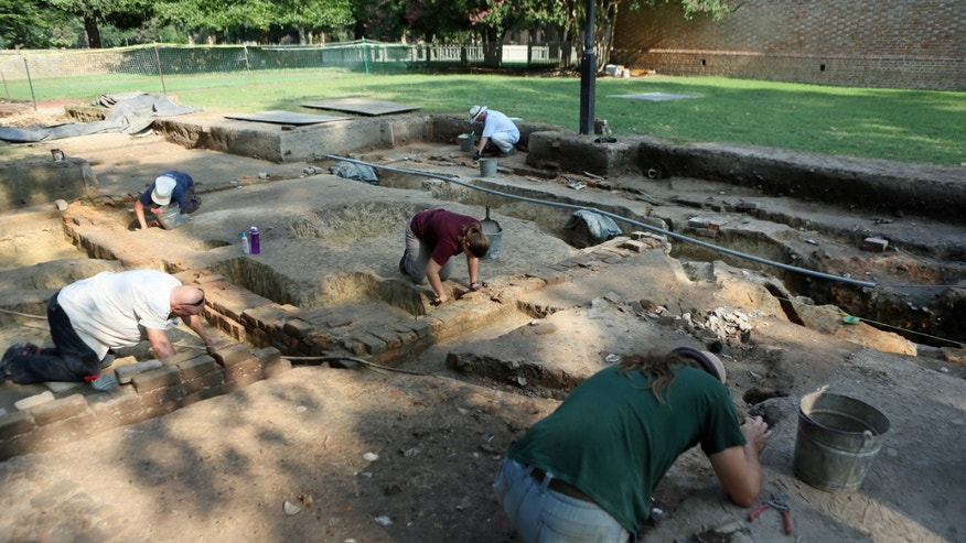 Archaeologists from the Colonial Williamsburg Foundation at work on the site of the recent archaeological dig on the campus of the College of William & Mary that unearthed the foundation of what is believed to be a campus brewery dating to the 18th century.