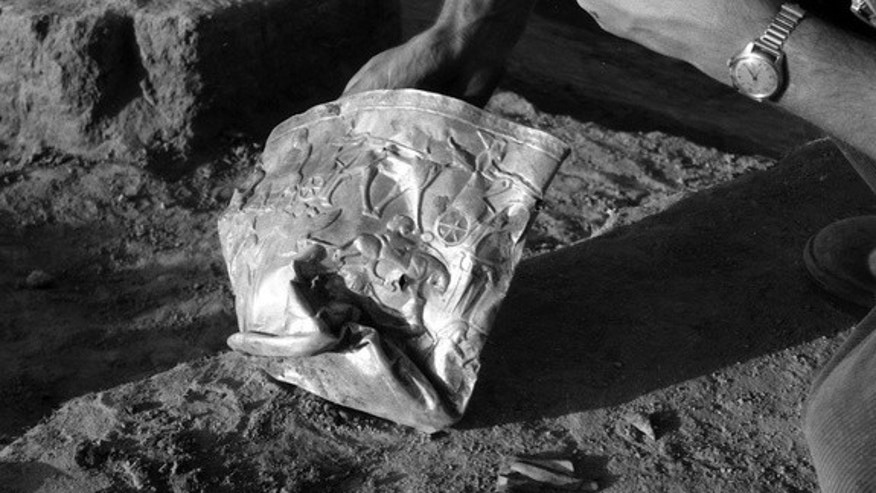 The flattened golden bowl found at Hasanlu in 1958.