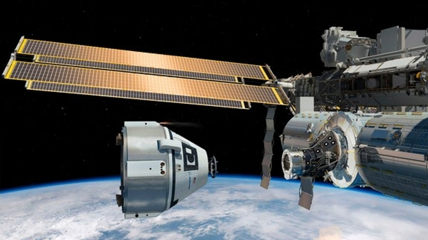 A Boeing CST-100 spacecraft is shown near the International Space Station in this artist's rendering of the commercial manned spacecraft for astronauts.