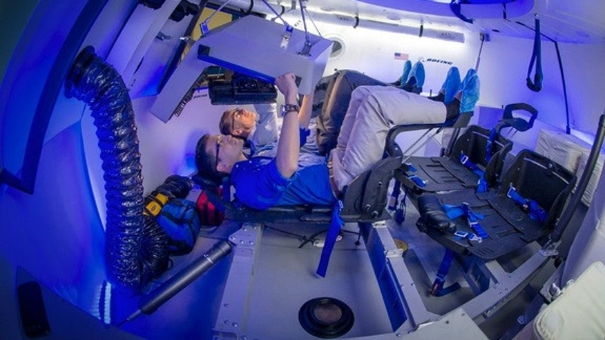 A look inside the interior of Boeing's commercial CST-100 space capsule for astronaut trips to and from low-Earth orbit.