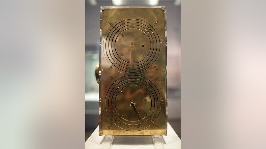 The front face of  the Antikythera Mechanism is seen at the National Archaeological Museum of Athens.