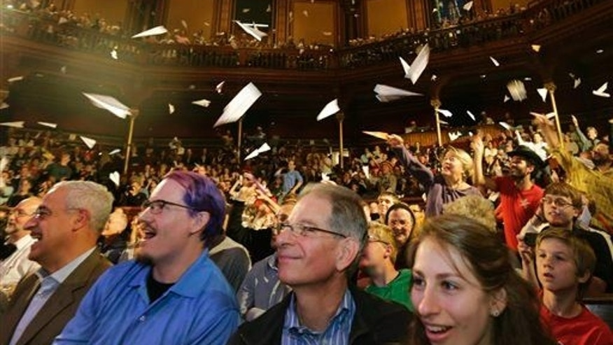 Audience members launch paper airplanes during a performance at the Ig Nobel Prize ceremony at Harvard University in Cambridge, Mass., on Sept. 18, 2014.
