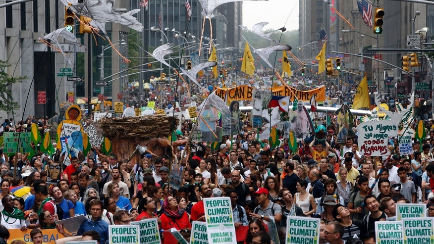 Demonstrators make their way down Sixth Avenue in New York during the People's Climate March.