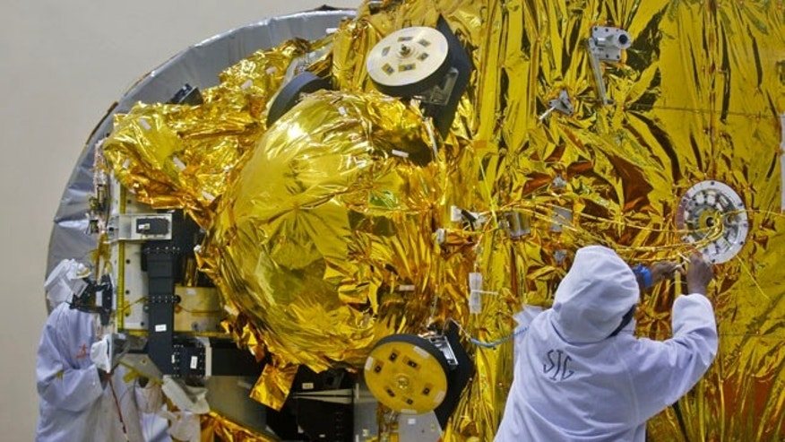 FILE - In this Sept. 11, 2013, file photo, Indian engineers work on the Mars orbiter spacecraft at the satellite center of Indian Space Research Organization (ISRO) in Bangalore, India. (AP Photo/Aijaz Rahi, File)
