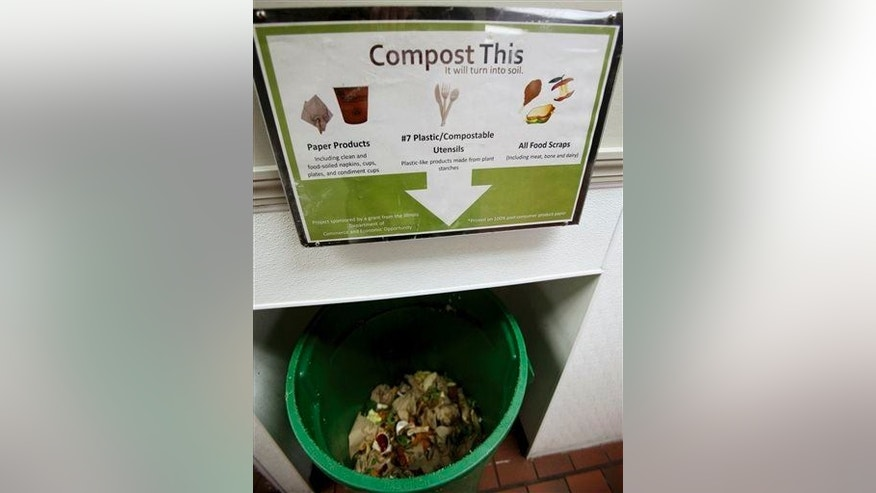 This May 14, 2014, photo shows a bin for leftover food scraps at North Central College in Naperville, Ill., where students have been composting in their cafeteria for three years.