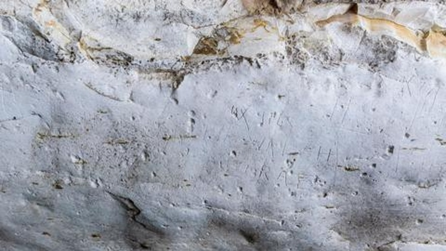 The engraved graffiti left by the Australian soldiers.