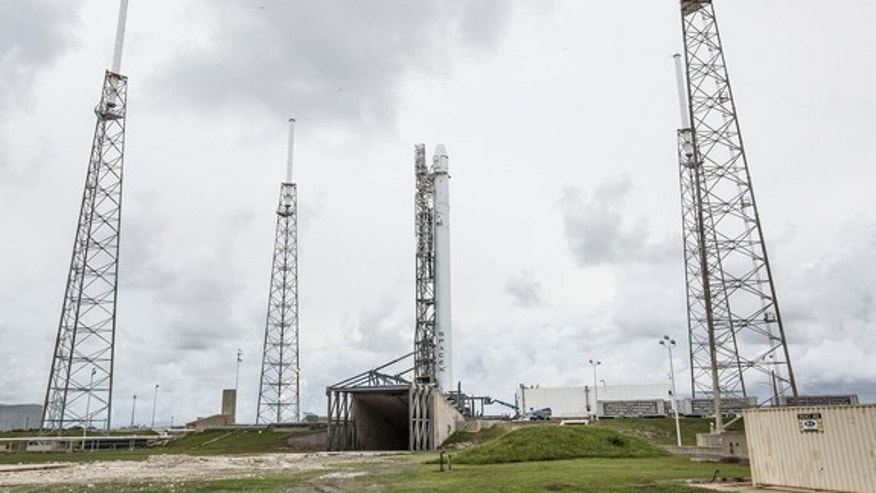 SpaceX's Falcon 9 rocket stands on a launchpad before blasting off into space on Sept. 19, 2014.