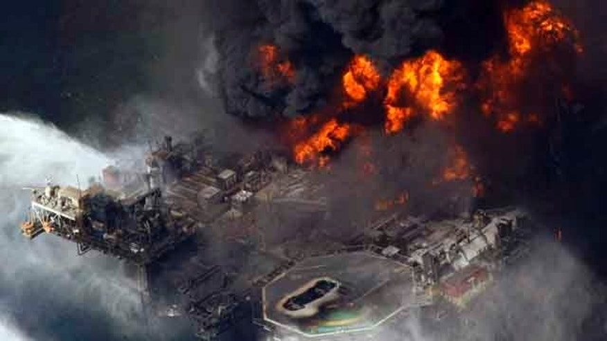 FILE - In this April 21, 2010 file aerial photo taken in the Gulf of Mexico more than 50 miles southeast of Venice on Louisiana's tip, the Deepwater Horizon oil rig is seen burning. (AP Photo/Gerald Herbert, File)