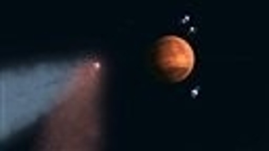 This handout artist's concept provided by NASA/JPL shows the Comet Siding Spring approaching Mars, shown with NASAs orbiters preparing to make science observations of this unique encounter. A pristine distant comet created a once-in-eight-million-year fireworks show on Mars and no humans were there to witness it. But new NASA data from satellites circling Mars released Friday shows that on Oct. 19 when Comet Siding Spring skimmed the red planet, tons of comet dust bombarded the Martian sky with thousands of fireballs an hour. It warped the Martian atmosphere leaving all sorts of metals and an eerie yellow afterglow. (AP Photo/NASA/JPL)