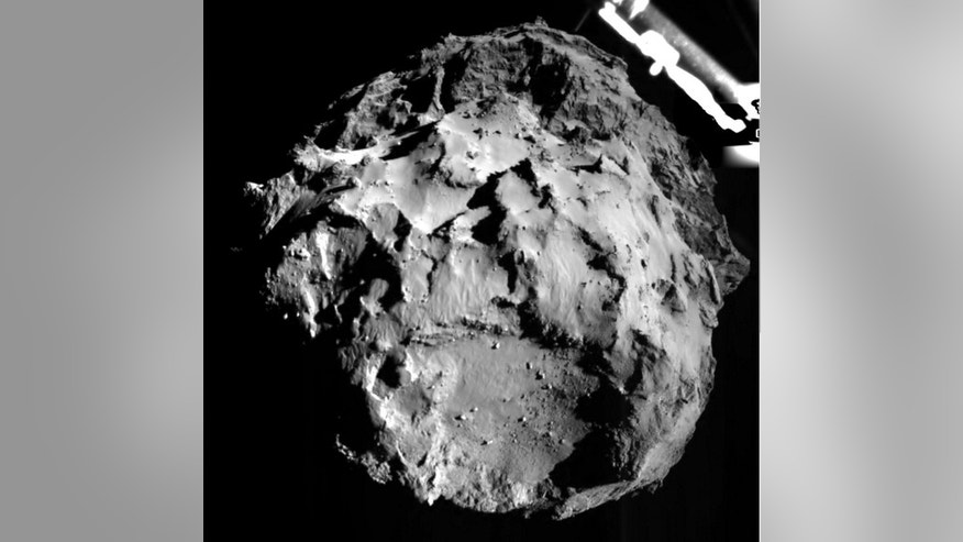 This image of 67P/CG was shot by Philae's ROLIS instrument during descent. The lander was approximately 2 miles from the comet's surface when the image was taken.