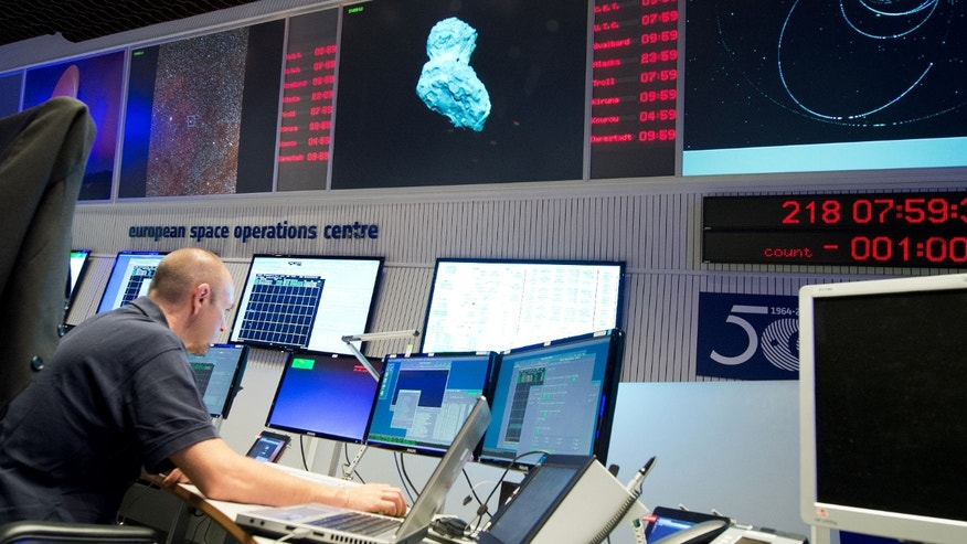 Aug 6, 2014: Expert watching his screens at the control center of the European Space Agency, ESA, in Darmstadt, Germany