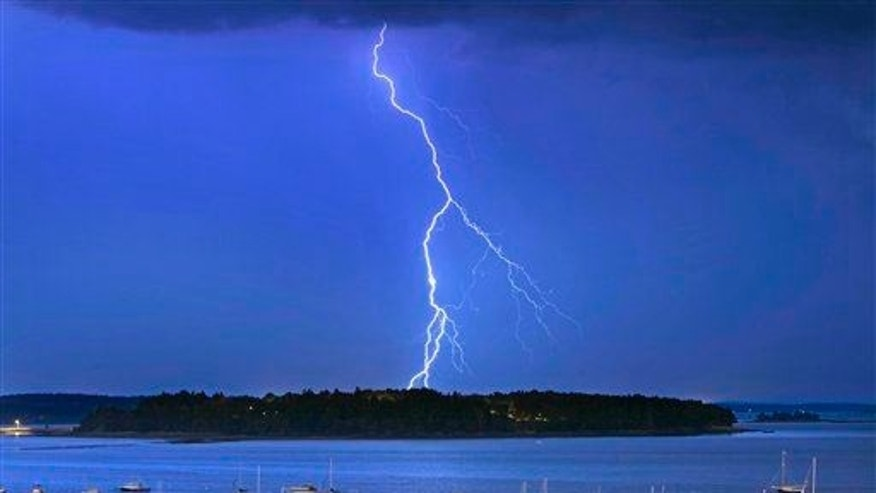 In this Sept. 11, 2013, file photo, lightning strikes north of Mackworth Island in Maine.