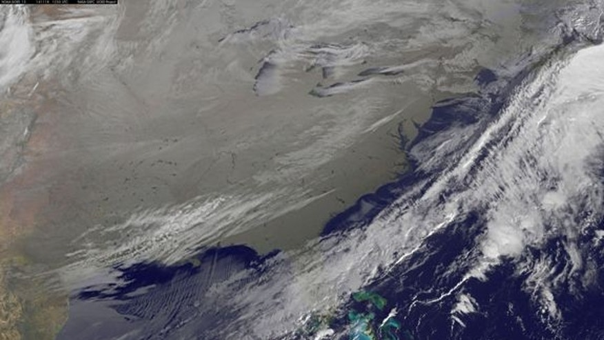 In this image, captured in infrared light by the National Oceanic and Atmospheric Agency's GOES-East satellite on Nov. 18, 2014, the cold air over the central and eastern U.S. looks like a gray-white blanket.