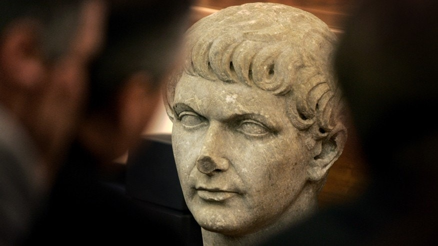 File photo of marble head statue representing Roman emperor Trajan.