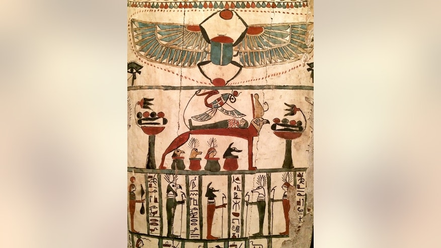 The funerary scene shown here is remarkably weird. The deceased is shown on a funerary bed which has a human headed bird called a Ba. A flying snake wearing the crown of Hathor (an Egyptian goddess) is shown above the deceased. The four jars ar