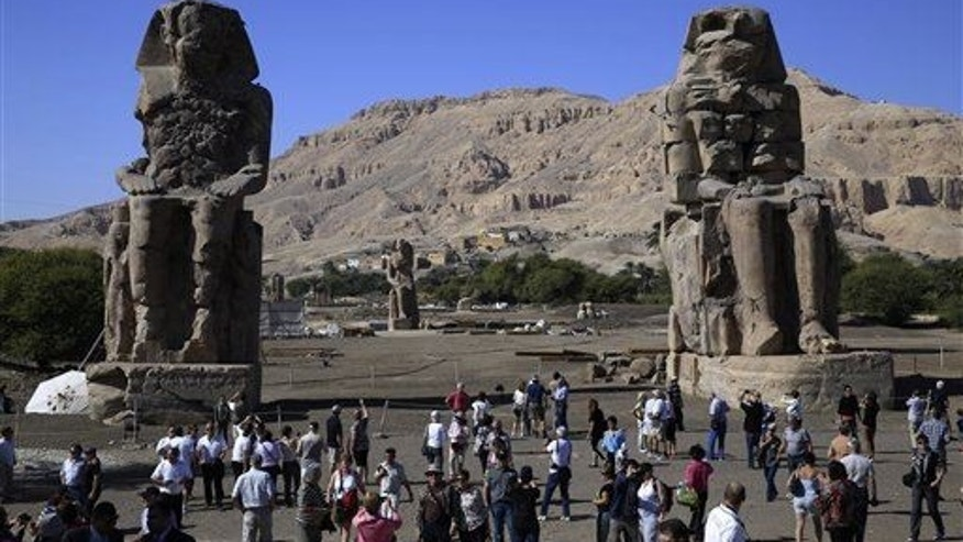 The statue was re-erected the king's funerary temple, which is already known for its Colossi of Memnon, two massive stone statues of Pharaoh Amenhotep III shown here.