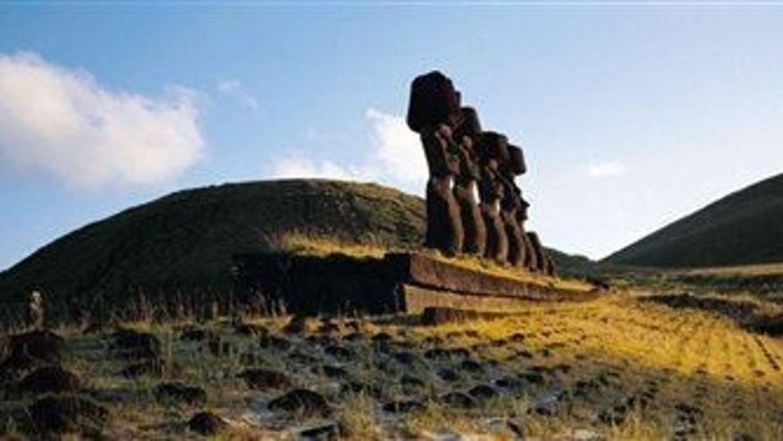 "Some of the massive Moai statues on Easter Island, Earth's most remote inhabited land, a South Pacific speck of volcanic rock so isolated the locals call it ""The Navel of the World."""