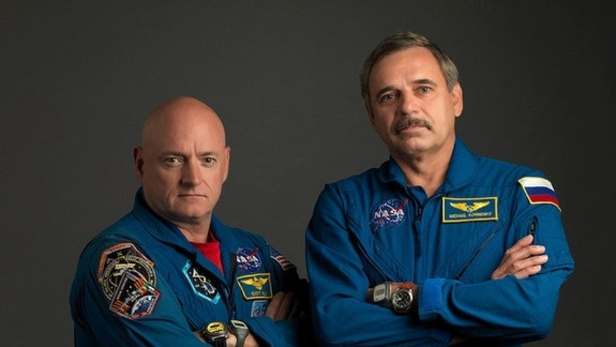 NASA astronaut Scott Kelly (left), the Expedition 43/44 flight engineer and Expedition 45/46 commander; and Russian cosmonaut Mikhail Kornienko, the Expedition 43-46 flight engineer, will serve one full year on the International Space Station s