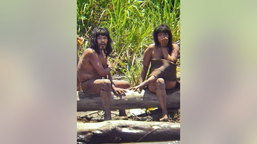This Nov. 2011 file photo shows members of the Mashco-Piro tribe, photographed at an undisclosed location near the Manu National Park in southeastern Peru.