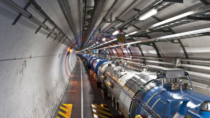 Large Hadron Collider tunnel photograph by Maximilien Brice.