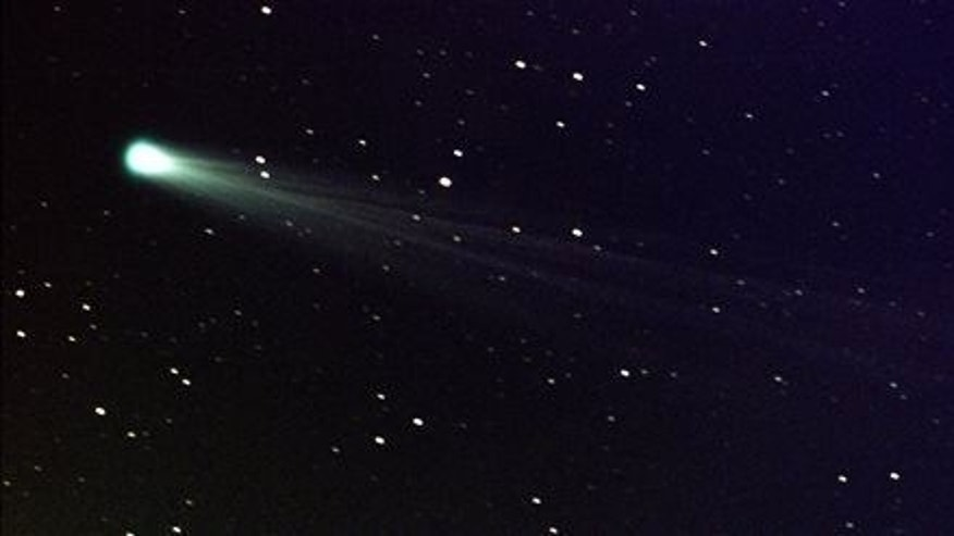 In this photo provided by NASA, Comet ISON shows off its tail in this three-minute exposure taken on Nov. 19, 2013, using a 14-inch telescope located at the Marshall Space Flight Center.