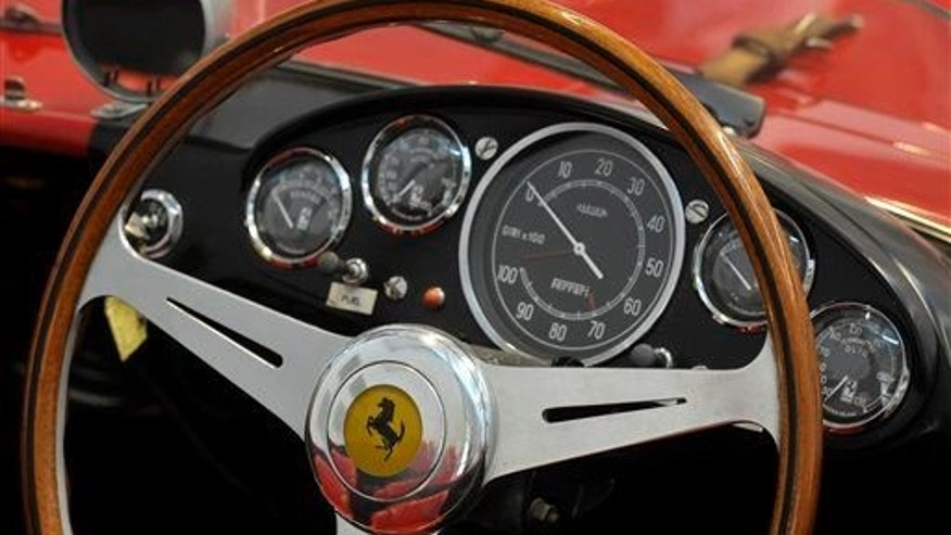 This file photo shows a Ferrari logo on a steering wheel at the Ferrari department factory in Maranello, Italy.