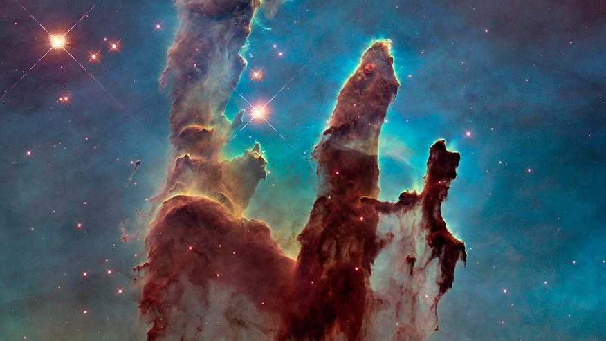 A Hubble telescope photograph of the iconic Eagle Nebula 'Pillars of Creation' is seen in this NASA image released January 6, 2015.