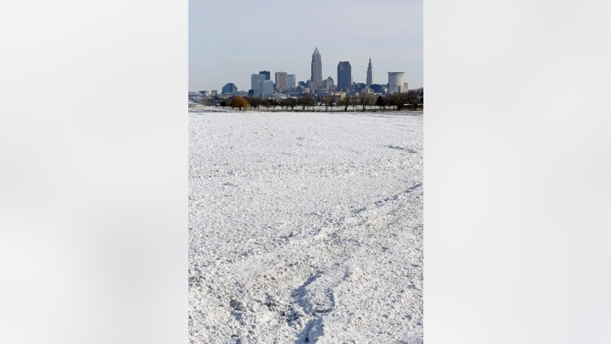 The Lake Erie ice pack hugs the shoreline west of downtown Cleveland Thursday, Jan. 8, 2015.