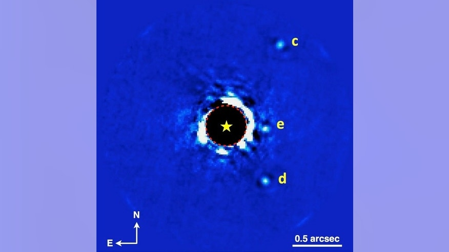 Gemini Planet Imager (GPI) photo of the planetary system HR 8799, showing three of the system's four known planets. (The star is in the middle; planet b is outside the field of view shown here, off to the left.) These data were obtained on Nov.