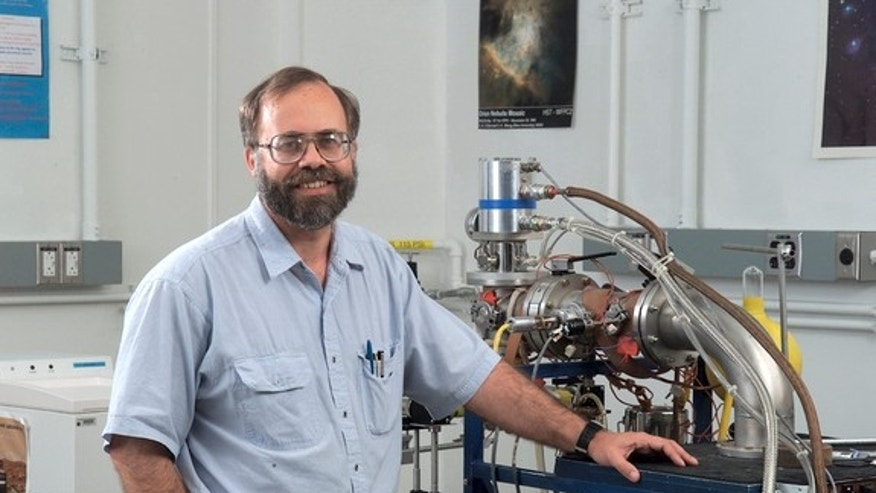 Scott Sandford next to a cryovacuum systems that helps reveal the chemistry that produces organic compounds of astrobiological interest.