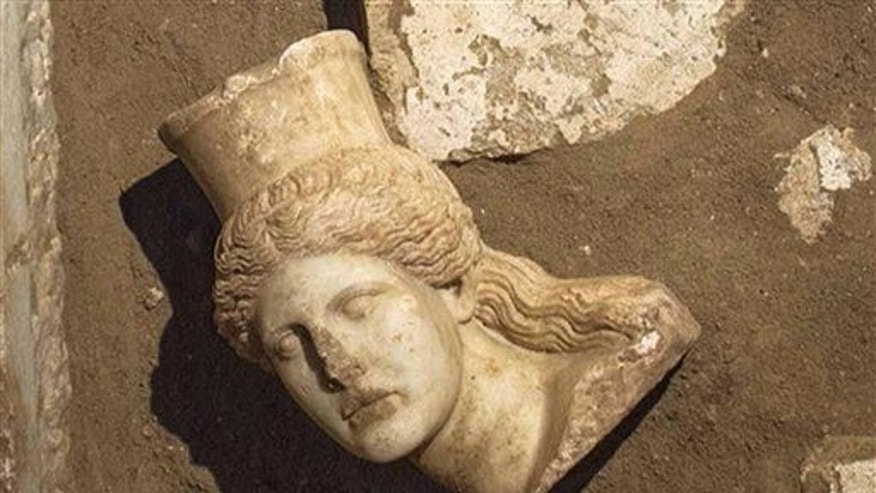 This picture provided by Greece's Culture Ministry, Oct. 20, 2014, shows the head of a marble sphinx, which adorned the entrance of a 4th-century-BC tomb under excavation at Amphipolis in Greece.