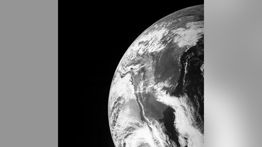 Earth is seen in this image taken by NASA's JunoCam as it flew by Earth, using its gravity to get a boost needed to reach Jupiter on October 9, 2013, in this NASA handout image released to Reuters on October 21, 2013.