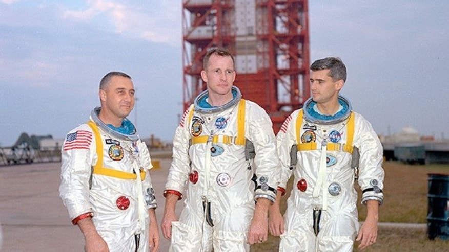 Apollo 1 astronauts (left to right) Gus Grissom, Ed White, and Roger Chaffee posing in front of Launch Complex 34 at Cape Canaveral Air Force Station in Florida. All three were killed when a fire blazed up in their capsule during a ground test