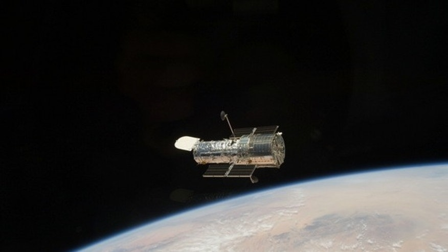 The Hubble Space Telescope is an icon in space that has peered deep into the universe for 25 years. In May 2009, astronauts on NASA's space shuttle Atlantis captured this farewell photo of Hubble near the end of the final servicing mission to t