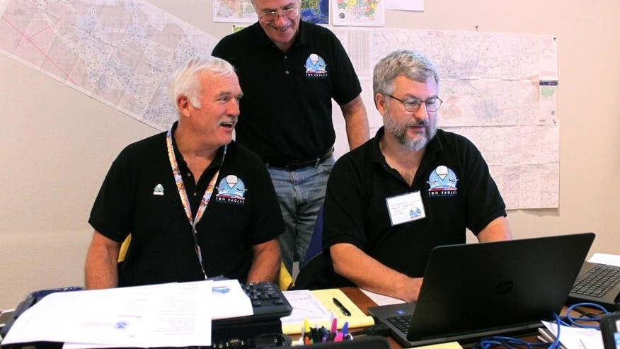 Left to right, team members Guy Feltman, Kevin Miko and Paul Jorgenson look at the projected path of the Two Eagles Balloon while at mission control in Albuquerque, N.M., on Friday, Jan. 30, 2015. The balloon surpassed a world duration record on Friday after being aloft over the Pacific Ocean more than 138 hours. (AP Photo/Susan Montoya Bryan)