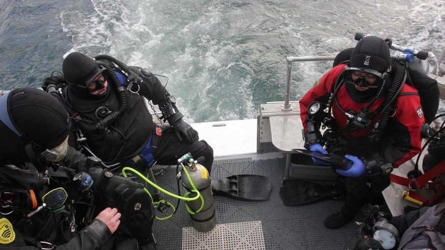 In this photograph taken January 12, 2015, volunteer divers are transported to a diving spot prior to entering the water of the Puget Sound near Seattle. Every year, the Seattle Aquarium enlists the help of volunteer divers to search and count giant pacific octopus in the Puget Sound for an underwater census.  (AP Photo/Manuel Valdes)