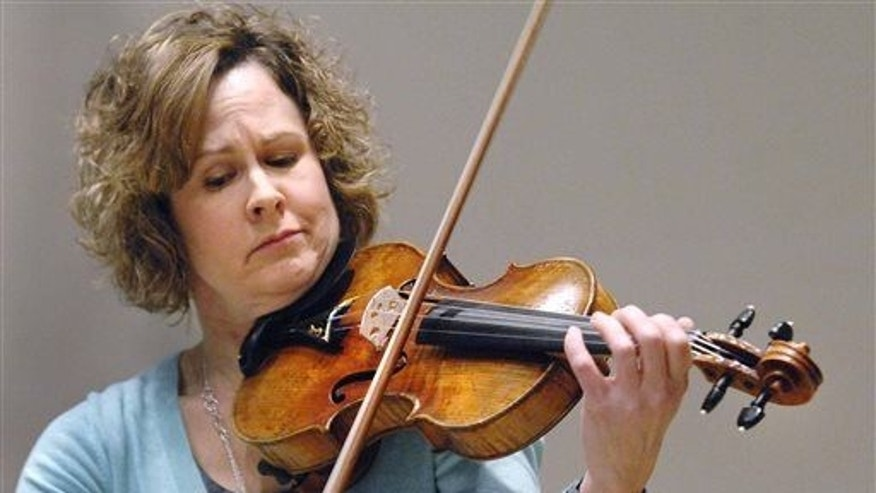 Sarah Gentry, professor of violin at Illinois State University, plays a violin in Normal, Ill.