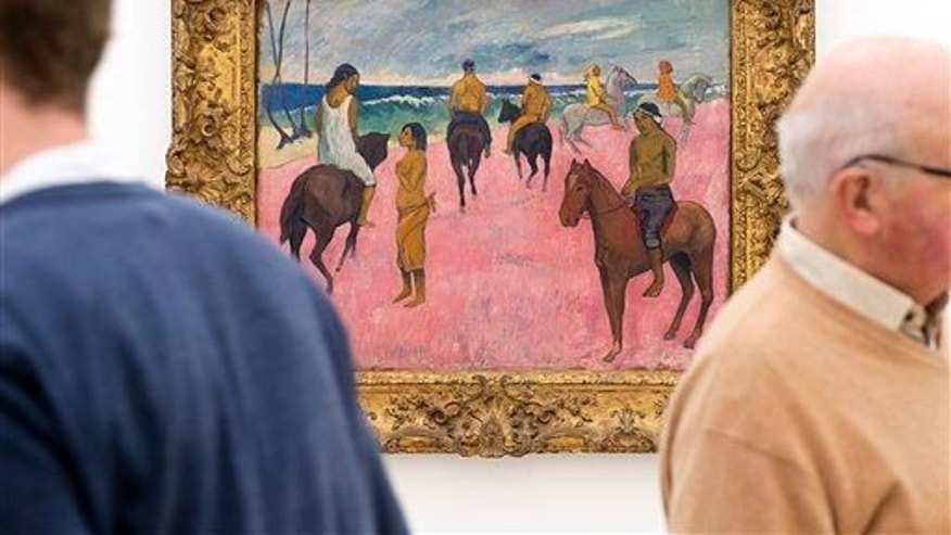 "Two men stand next to ""Cavaliers sur la plage"" (Riders on the beach, 1902) by French painter Paul Gauguin at an exhibition  in the Fondation Beyeler in Riehen, Switzerland, on Friday, Feb.  6, 2015."