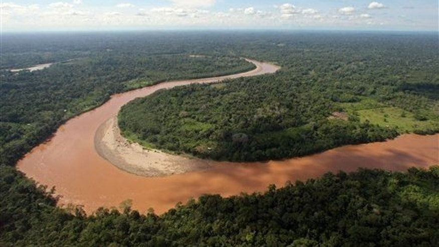 The San Miguel River marks the border between Ecuador, blow and left of river, with Colombia, Thursday Sept. 16, 2010.