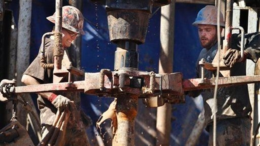 In this Tuesday, Feb. 21, 2012 photo, oil field workers drill into the Gypsum Hills near Medicine Lodge, Kan.