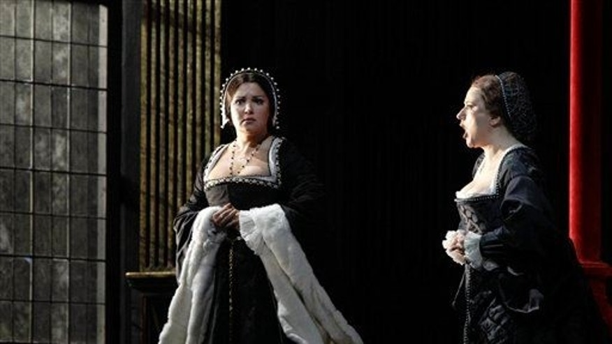 "In this Sept. 22, 2011 photo, Anna Netrebko, left, portrays Anne Boleyn, with Ekaterina Gubanova as Jane Seymour in Gaetano Donizetti's ""Anna Bolena,"" at the Metropolitan Opera in New York."