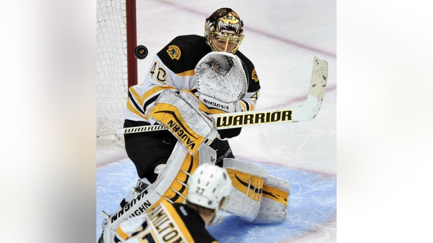 Boston Bruins goalie Tuukka Rask (40) of Finland, makes a save during the third period of an NHL hockey game against the Chicago Blackhawks in Chicago, Sunday, Feb. 22, 2015. Boston won 6-2. (AP Photo/Paul Beaty)