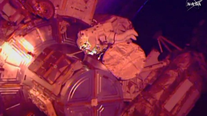 March 1, 2015: In this image from NASA television astronaut Terry Virts exits the Quest airlock hatch beginning the third spacewalk outside the International Space Station. (AP/NASA-TV)