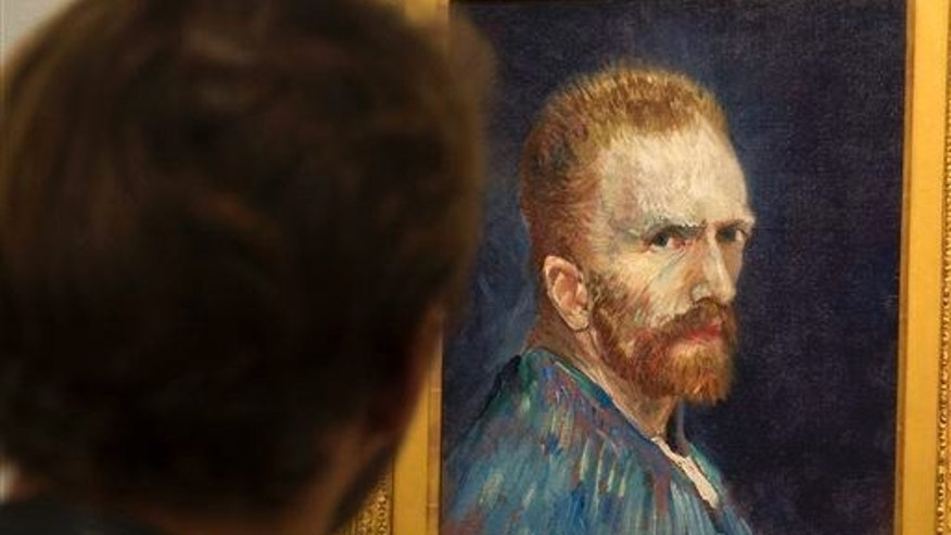 A patron looks at a self portrait by Vincent Van Gogh at the Museum of Fine Arts, Tuesday, Oct. 7, 2014, in Montreal.