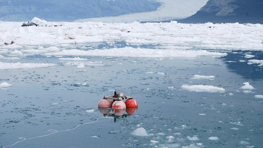 In this photo taken May 14, 2009 and provided by the University of Washington, is the deployment of a hydrophone in Icy Bay, Alaska. Glaciologist Erin Pettit began a research project to find out what calving glacier ice sounded like to a humpback whale. The sound of the ice in the water turned out to be more interesting. Acoustic research in Alaska's Icy Bay and other glacier ice-filled waters found that the fizz created by the release of air bubbles under high pressure makes fjords with glacier icebergs the noisiest places in the ocean. (AP Photo/University of Washington, Jeffrey Nystuen)
