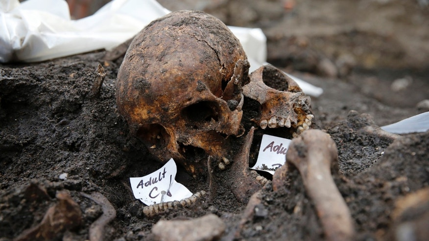 Skeletons found in the Bedlam burial ground on the future site of a Crossrail ticket hall are seen next to Liverpool Street Station in London.