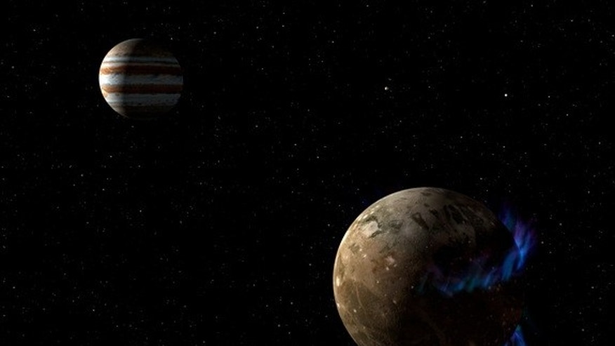 In this artist's conceptual illustration, the moon Ganymede orbits giant planet Jupiter. NASA's Hubble Space Telescope detected auroras on the moon controlled by Ganymede's magnetic fields. Image released March 12, 2015.