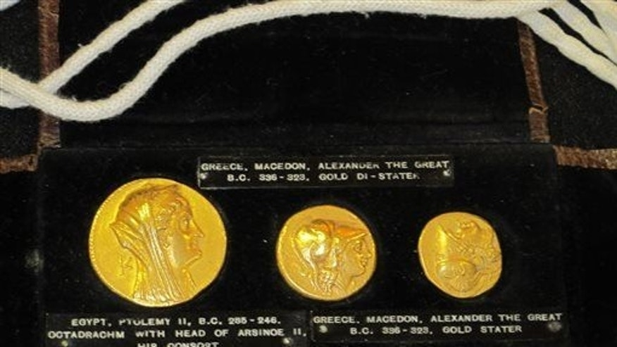 A trio of ancient gold Greek coins on display, Wednesday, March 11, 2015, in Buffalo, NY.