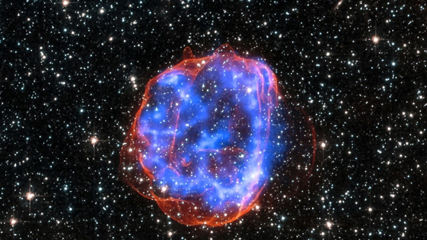 File photo - an expanding shell of debris called SNR 0519-69.0 is left behind after a massive star exploded in the Large Magellanic Cloud, a satellite galaxy to the Milky Way.